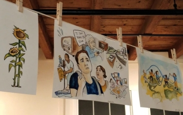 Drawings hanging from clothesline